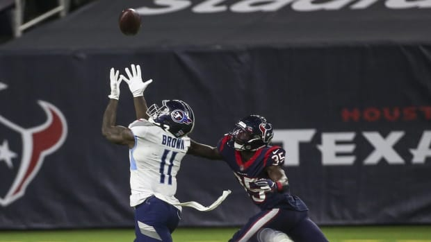 Tennessee Titans wide receiver A.J. Brown (11) makes a reception during the fourth quarter as Houston Texans cornerback Keion Crossen (35) defends at NRG Stadium.