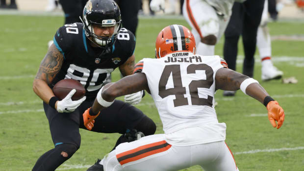 Nov 29, 2020; Jacksonville, Florida, USA; Jacksonville Jaguars tight end James O'Shaughnessy (80) runs against Cleveland Browns strong safety Karl Joseph (42) during the second half at TIAA Bank Field.