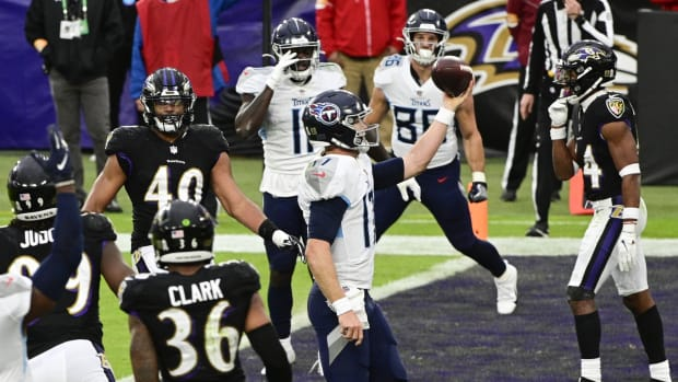 Tennessee Titans quarterback Ryan Tannehill (17) scores a two point conversion during the fourth quarter against the Baltimore Ravens at M&T Bank Stadium.