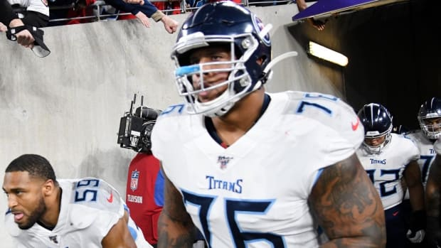 Tennessee Titans linebacker Wesley Woodyard (59) and guard Rodger Saffold III (76) takes the field for the NFL Divisional Playoff game against Baltimore Ravens at M&T Bank Stadium Saturday, Jan. 11, 2020 in Baltimore, Md.