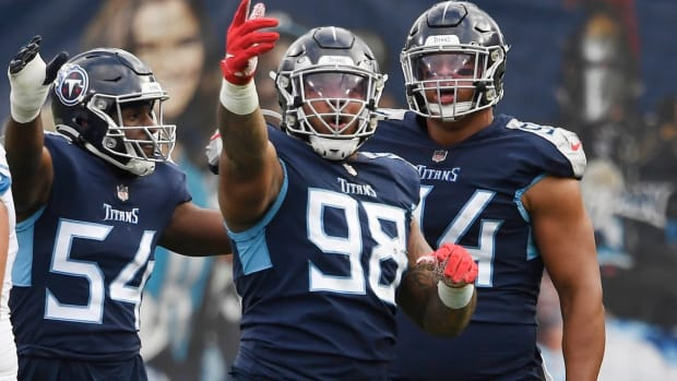 Tennessee Titans defensive end Jeffery Simmons (98) points to the Jumbotron after recovering a fumble on a play under review during the third quarter at Nissan Stadium Sunday, Dec. 20, 2020 in Nashville, Tenn.