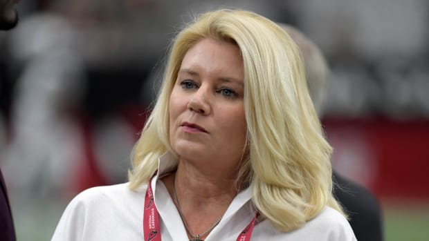 icole Bidwill watches from the sidelines during an NFL football game between the against the Oakland Raiders and the Arizona Cardinals. She is the wife of Cardinals president Michael Bidwill.