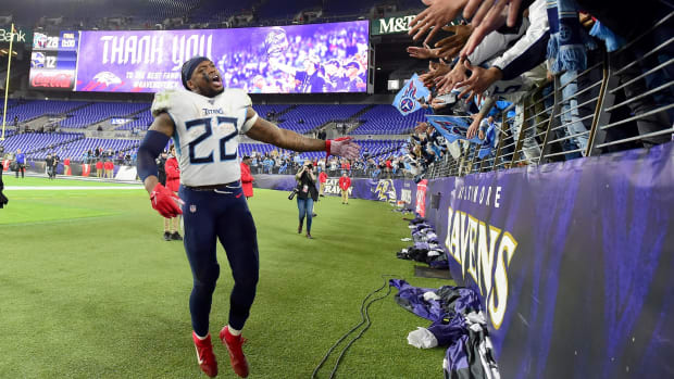 Tennessee Titans running back Derrick Henry (22) celebrates with fans after beating the Baltimore Ravens 28-12 in a AFC Divisional Round playoff football game at M&T Bank Stadium.