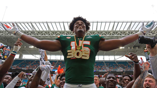 Sep 21, 2019; Miami Gardens, FL, USA; Miami Hurricanes defensive lineman Gregory Rousseau (15) celebrates by wearing the turnover chain after recovering a fumble in the first quarter of a football game against the Central Michigan Chippewas at Hard Rock Stadium.