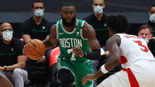 Jaylen Brown is guarded by Toronto Raptors forward OG Anunoby