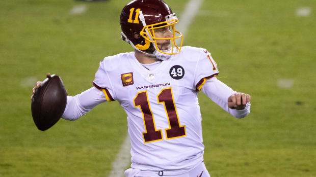 Jan 3, 2021; Philadelphia, Pennsylvania, USA; Washington Football Team quarterback Alex Smith (11) passes the ball against the Philadelphia Eagles during the third quarter at Lincoln Financial Field.