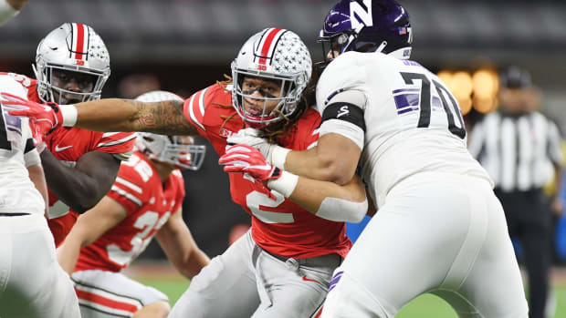 Dec 1, 2018; Indianapolis, IN, USA; Ohio State Buckeyes defensive end Chase Young (2) rushes the line (2) in the first half against Northwestern Wildcats lineman Rashawn Slater (70) in the Big Ten conference championship game at Lucas Oil Stadium. Mandatory Credit: Thomas J. Russo-USA TODAY Sports