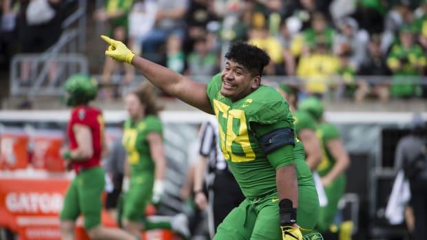 Oregon LT Penei Sewell celebrating