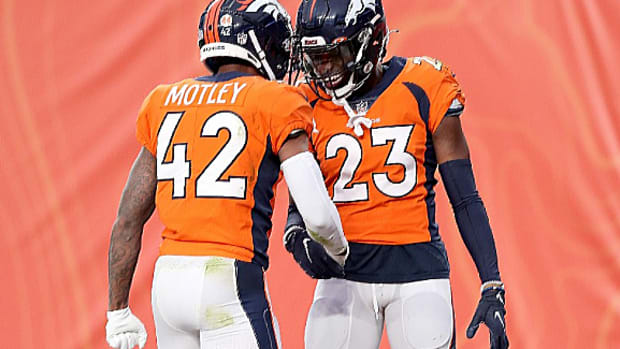 Michael Ojemudia #23 of the Denver Broncos celebrates with Parnell Motley #42 after recovering a fumble against the Las Vegas Raiders in the second quarter at Empower Field At Mile High on January 03, 2021 in Denver, Colorado.