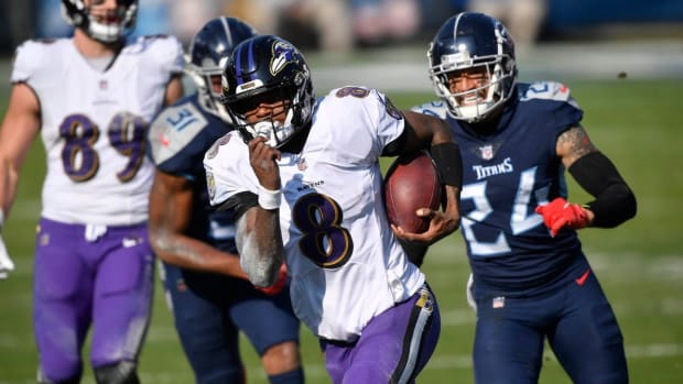 Baltimore Ravens quarterback Lamar Jackson (8) runs for a touchdown during the Tennessee Titans game against the Baltimore Ravens in Nashville on January 10, 2021.