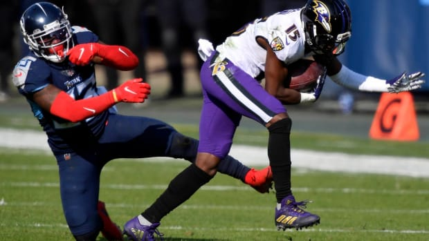 Baltimore Ravens wide receiver Marquise Brown (15) gets away from Tennessee Titans cornerback Desmond King II (33) during the Tennessee Titans game against the Baltimore Ravens in Nashville on January 10, 2021.