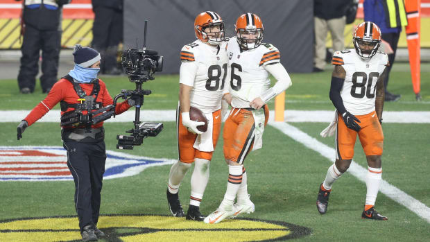Jan 10, 2021; Pittsburgh, PA, USA; Cleveland Browns tight end Austin Hooper (81) celebrates after catching a touchdown pass from quarterback Baker Mayfield (6) against the Pittsburgh Steelers in the second quarter of an AFC Wild Card playoff game at Heinz Field. Mandatory Credit: Charles LeClaire-USA TODAY Sports