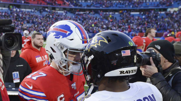 Dec 8, 2019; Orchard Park, NY, USA; Buffalo Bills quarterback Josh Allen (17) meets Baltimore Ravens quarterback Lamar Jackson (8) at mid-field after a game at New Era Field. Mandatory Credit: Mark Konezny-USA TODAY Sports