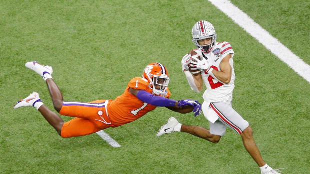 Jan 1, 2021; New Orleans, LA, USA; Ohio State Buckeyes wide receiver Chris Olave (2) makes a catch for a touchdown as Clemson Tigers cornerback Derion Kendrick (1) is unable to break up the play during the third quarter at Mercedes-Benz Superdome. Mandatory Credit: Russell Costanza-USA TODAY Sports