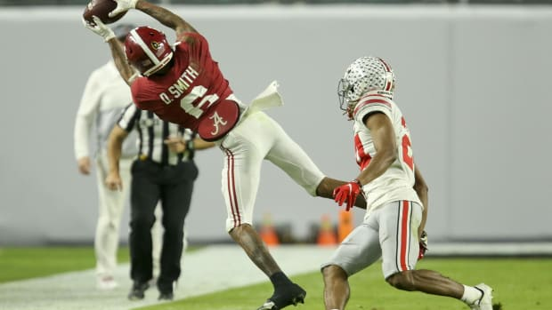 Jan 11, 2021; Miami Gardens, Florida, USA; Alabama wide receiver DeVonta Smith (6) hauls in a catch along the sideline with Ohio State cornerback Shaun Wade (24) defending during the College Football Playoff National Championship Game in Hard Rock Stadium. Mandatory Credit: Gary Cosby-USA TODAY Sports