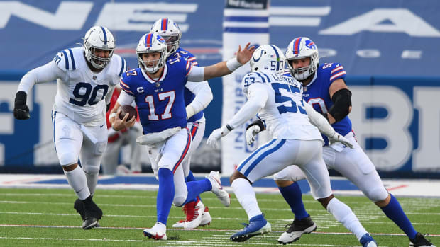 Bills quarterback Josh Allen (17) runs between Indianapolis Colts defensive tackle Grover Stewart (90) and outside linebacker Darius Leonard (53).