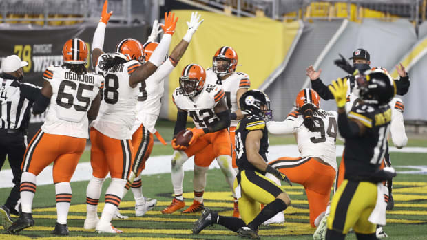Cleveland Browns strong safety Karl Joseph (42) celebrates after recovering a fumble for a touchdown against the Pittsburgh Steelers in the first half of an AFC Wild Card playoff game at Heinz Field.