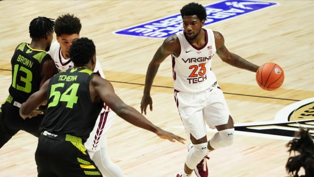 Nov 29, 2020; Uncasville, Connecticut, USA; Virginia Tech Hokies guard Tyrece Radford (23) drives the ball against the South Florida Bulls in the first half at Mohegan Sun Arena.