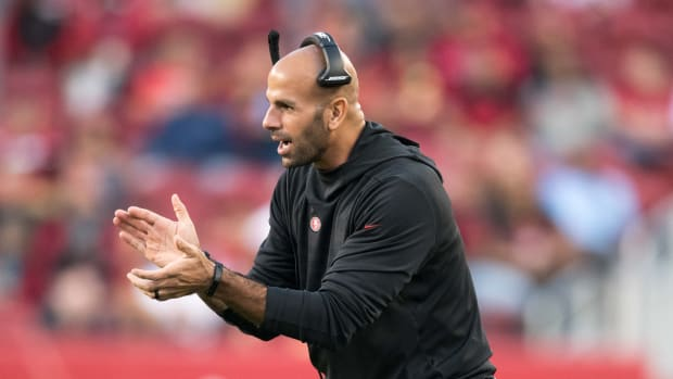 Robert Saleh clapping on 49ers sideline