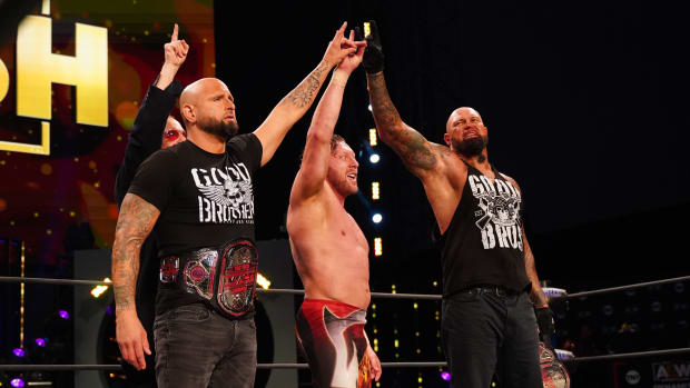 Doc Gallows, Karl Anderson and Kenny Omega pose in the ring on AEW Dynamite