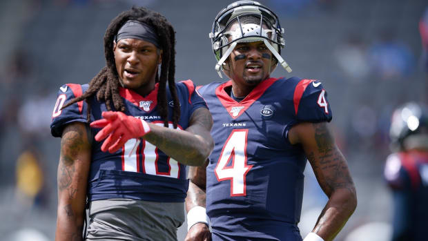 Houston Texans quarterback Deshaun Watson (4) speaks with wide receiver DeAndre Hopkins (10) prior to the game against the Los Angeles Chargers at Dignity Health Sports Park.