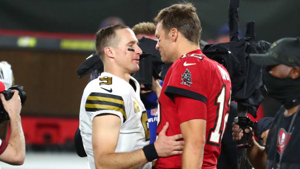 Drew Brees and Tom Brady greet each other after a game.