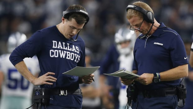 Kellen Moore (left) with then-head coach Jason Garrett in Dallas is expected to be interviewed for Eagles head coaching job