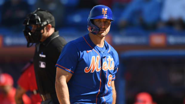 Feb 28, 2020; Port St. Lucie, Florida, USA; New York Mets outfielder Tim Tebow walks back to the dugout after striking out in the fourth inning against the St. Louis Cardinals at Clover Park.