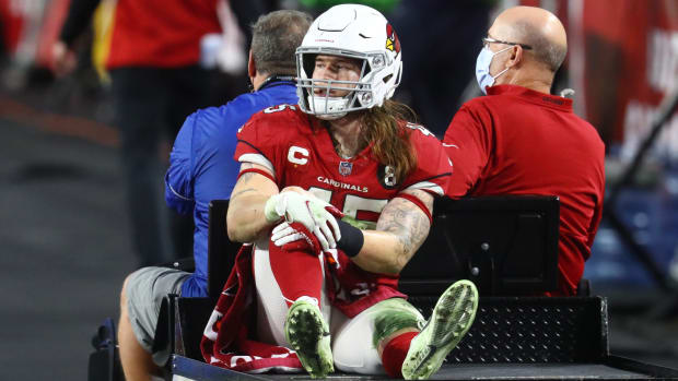 An injured Arizona Cardinals linebacker Dennis Gardeck (45) is carted off the field against the Philadelphia Eagles at State Farm Stadium.
