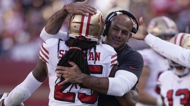 49ers Richard Sherman hugs Robert Saleh