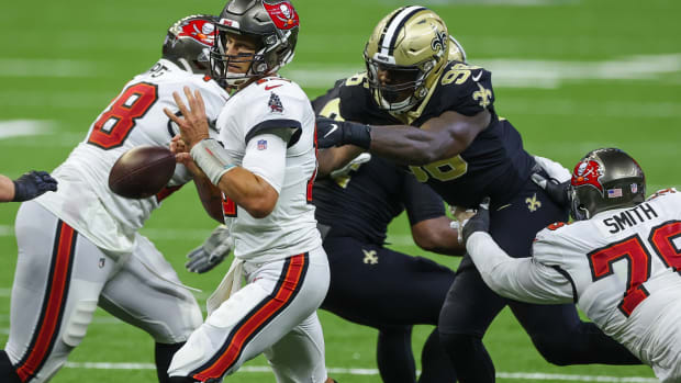 Sep 13, 2020; New Orleans, Louisiana, USA; Tampa Bay Buccaneers quarterback Tom Brady (12) fumbles as New Orleans Saints defensive end Carl Granderson (96) knocks away the ball during the fourth quarter at the Mercedes-Benz Superdome. Mandatory Credit: Derick E. Hingle-USA TODAY Sports