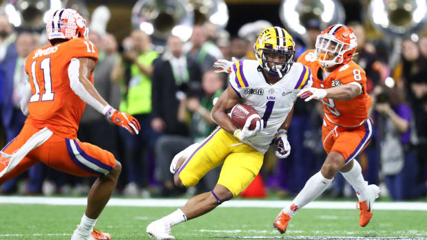Jan 13, 2020; New Orleans, Louisiana, USA; LSU Tigers wide receiver Ja'Marr Chase (1) runs between Clemson Tigers linebacker Isaiah Simmons (11) and cornerback A.J. Terrell (8) first half in the College Football Playoff national championship game at Mercedes-Benz Superdome. Mandatory Credit: Mark J. Rebilas-USA TODAY Sports