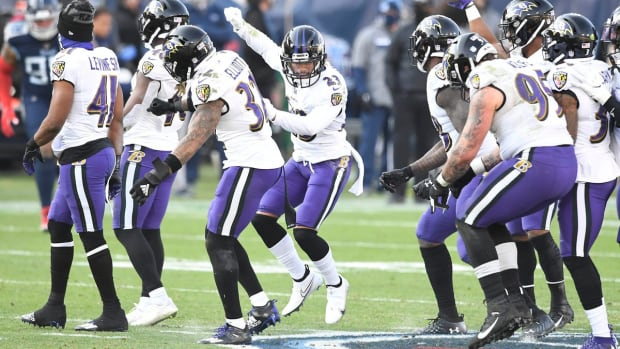 The Ravens stomp on the Titans logo during the Tennessee Titans game against the Baltimore Ravens in Nashville on January 10, 2021.