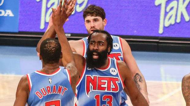 Brooklyn Nets guard James Harden (13) high fives forward Kevin Durant (7) during a time out in the second quarter against the Orlando Magic at Barclays Center.