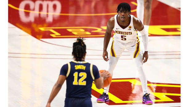 Jan 16, 2021; Minneapolis, Minnesota, USA; Minnesota Gophers guard Marcus Carr (5) guards Michigan Wolverines guard Mike Smith (12) during the first half at Williams Arena.