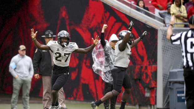 Dec 23, 2019; Tampa, Florida, USA; Central Florida Knights defensive back Richie Grant (27) reacts after scoring a touchdown during the first quarter against the Marshall Thundering Herd at Raymond James Stadium.