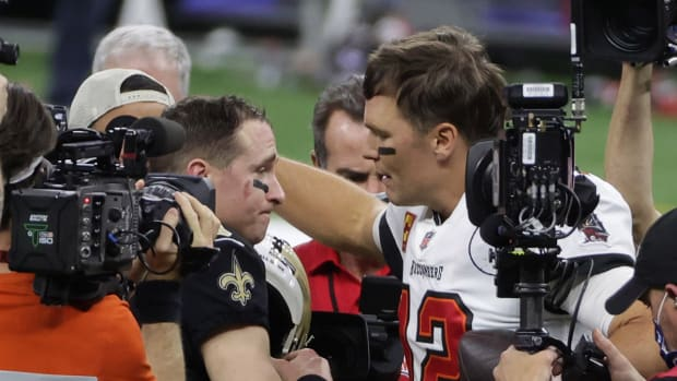 Drew Brees and Tom Brady after a playoff game