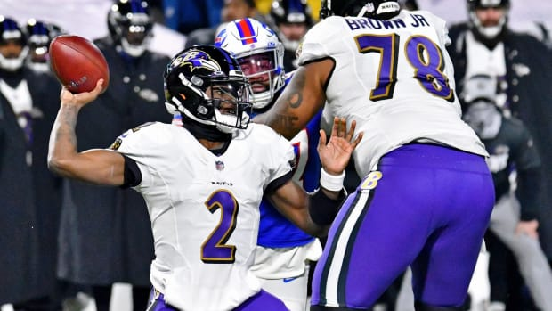 Jan 16, 2021; Orchard Park, New York, USA; Baltimore Ravens quarterback Tyler Huntley (2) throws the ball against the Buffalo Bills during the second half of an AFC Divisional Round playoff game at Bills Stadium. The Buffalo Bills won 17-3.