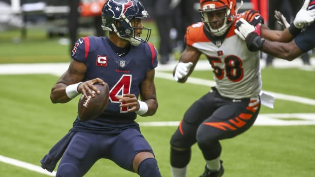 Dec 27, 2020; Houston, Texas, USA; Houston Texans quarterback Deshaun Watson (4) looks for an open receiver against the Cincinnati Bengals during the second quarter at NRG Stadium. Mandatory Credit: Troy Taormina-USA TODAY Sports