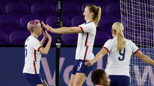 USWNT Sam Mewis celebrates with Megan Rapinoe