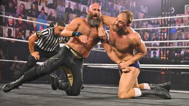 Timothy Thatcher strikes Tomasso Ciampa in the ring