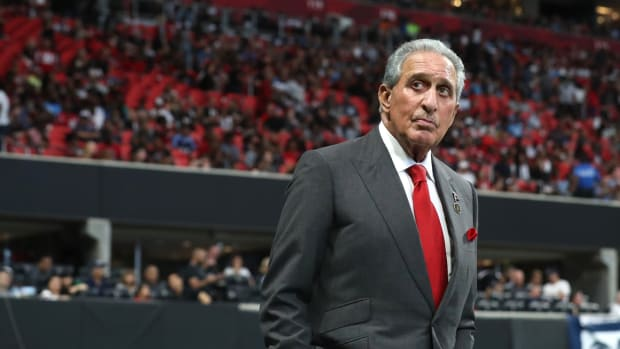 Atlanta Falcons owner Arthur Blank walks on the sideline during the fourth quarter against the Tennessee Titans at Mercedes-Benz Stadium.