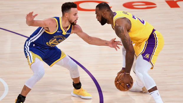 Stephen Curry guards LeBron James at the top of the key