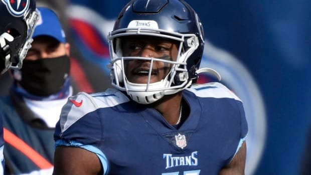 Tennessee Titans wide receiver A.J. Brown (11) celebrates a touchdown in the first quarter during the Tennessee Titans game against the Baltimore Ravens in Nashville on January 10, 2021.