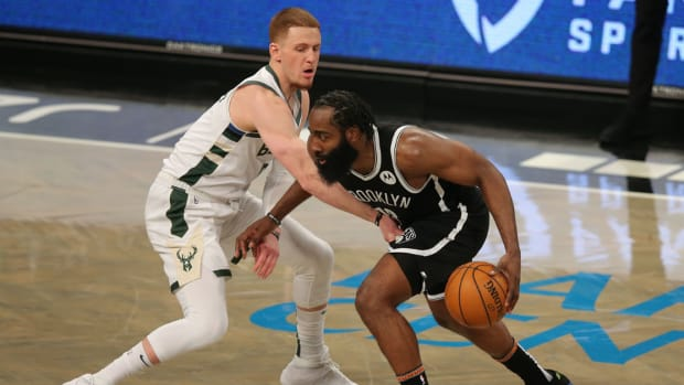 Jan 18, 2021; Brooklyn, New York, USA; Brooklyn Nets shooting guard James Harden (13) controls the ball against Milwaukee Bucks shooting guard Donte DiVincenzo (0) during the fourth quarter at Barclays Center. The Nets defeated the Bucks 125-123. Mandatory Credit: Brad Penner-USA TODAY Sports