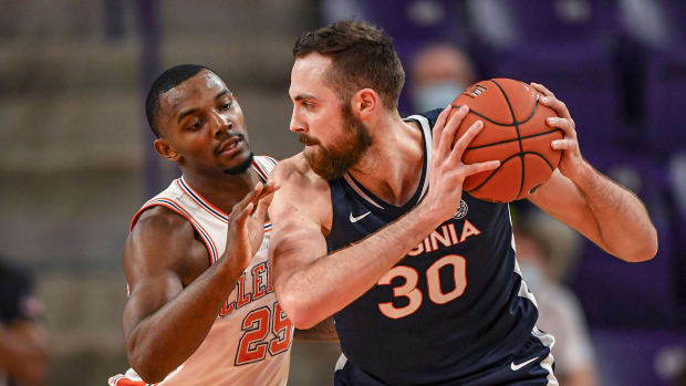 Virginia's Jay Huff dribbles against Clemson's Aamir Simms