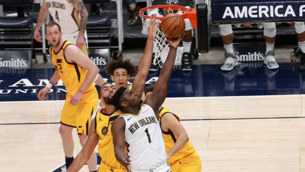 Jan 19, 2021; Salt Lake City, Utah, USA; New Orleans Pelicans forward Zion Williamson (1) goes to the basket while defended by Utah Jazz center Rudy Gobert (27) during the second quarter at Vivint Smart Home Arena.