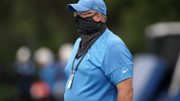 Aug 31, 2020; Costa Mesa, California, USA; Los Angeles Chargers offensive line coach James Campen wears a face covering during training camp at the Jack Hammett Sprots Complex.