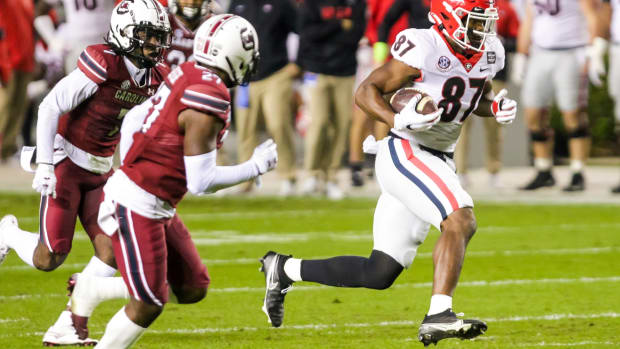 Nov 28, 2020; Columbia, South Carolina, USA; Georgia Bulldogs tight end Tre' McKitty (87) runs after the catch against the South Carolina Gamecocks during the first quarter at Williams-Brice Stadium.