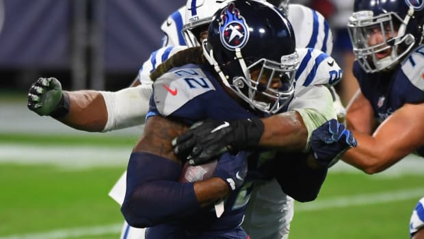 Tennessee Titans running back Derrick Henry (22) is tackled for a loss by Indianapolis Colts defensive tackle Grover Stewart (90) during the first half at Nissan Stadium.